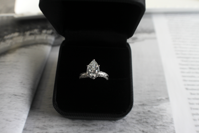 The stunning bespoke engagement ring set with a rare 2Ct pear cut diamond